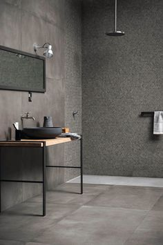 Dark and exclusive - a beautiful piece of furniture or a pendant will change the bath's character and creates the little surprise that makes it a nice and welcoming space. Contradictions of surfaces and textures further creates the surprise.
