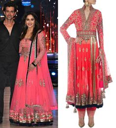 GET THIS LOOK: Madhuri Dixit - Nene looks as radiant as always in the coral pink embroidered Manish Malhotra ensemble.  Shop at http://www.perniaspopupshop.com/designers-1/manish-malhotra/manish-malhotra-coral-pinkish-embroidered-kalidaar-set-mmc0913sks226.html — with Shaista Syed.
