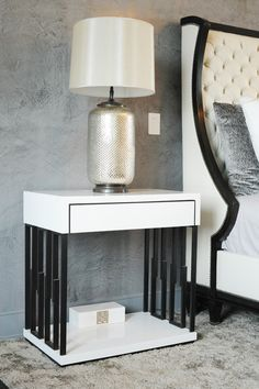 Modern gloss bedside table is fashionable nowadays.