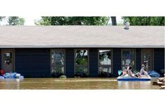 Flood aftermath photos in the Crooked lake area July 3, 2014. a family uses a paddle boat to survey damage.