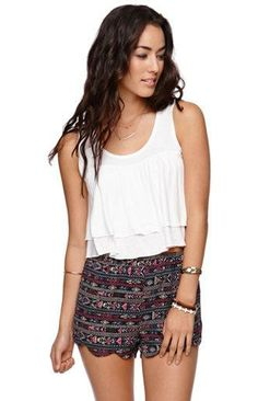 I'm falling in love with tribal print everything and I love the scallop detailing!