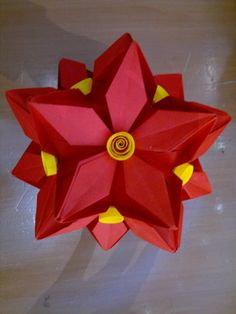 Red paper Kusudama with yellow quilling coils. A beautiful hanging piece.