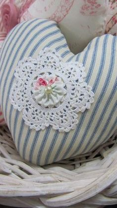Not crazy about the heart shape but do like the idea of a rosette in the center of a doilie on a pillow