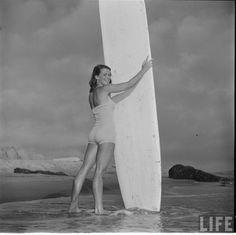 Long board surfer girl. 1950 Photographer: Loomis Dean