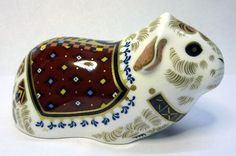 A Royal Crown Derby paperweight, Guinea Pig, with gold stopper and box, height 7.5cms