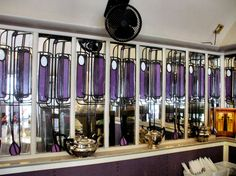Teapots aligned on shelf of Glasgow's Willow Tearooms designed by Charles Rennie Mackintosh