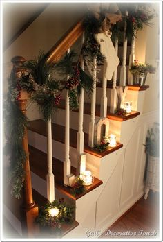Christmas Staircase Banister - Notice the J-O-Y letters behind the candles.  Beautiful