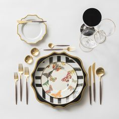 Black & Gold Anna Weatherley Charger + Christian Lacroix Dinnerware in Sol Y Sombra + Mackenzie-Childs Dinnerware in Butterfly Garden + White & Gold Anna Weatherley Bread Plate + GOA 24K Gold Flatware + 14K Gold Salt Cellars + Chloe Gold Rimmed Stemware & Chloe Gold Rimmed Stemware in Black | Casa de Perrin Design Presentation