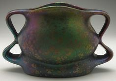 """Weller Sicard vase, unusual double handled shape with a stylized clover design, covered in a colorful metallic glaze, marked, signed, 9""""w x 5.5""""h  
