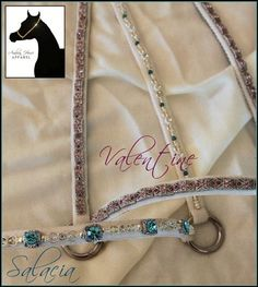 VALENTINE & SALACIA  Commission - pair of halters custom designed for a client's lovely cremello filly. 'Valentine' is solid bling, featuring well over 250 genuine Swarovski crystals. 'Salacia' is composed of elegant silver and crystal accents, alternated with stunning turquoise Swarovski accents
