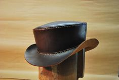 All hand-stitched with waxed linen threads, 4 stitches per inch. Stain colors available include saddle tan, natural antique, mahogany (also dark Mens Leather Hats, Leather Top Hat, Gentleman Hat, Leather Working Patterns, Steampunk Top Hat, Outfits With Hats, Types Of Shoes, Western Boots, Hats For Men