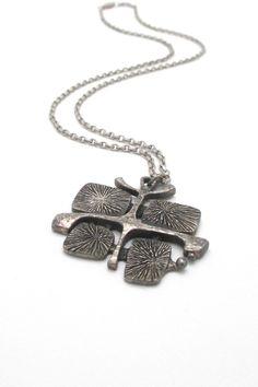 Guy Vidal, Canada - vintage brutalist pewter 'radiant plates' pendant necklace