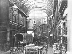 Leadenhall Market, London, 1897 Largely unchanged since this photograph was taken, the current Leadenhall Market in the city of London was designed in 1881 by Sir Horace Jones. In this photograph, people on the right sit outside what may be a coffee shop or cafe, whilst horses pull carts of goods. Originally, Leadenhall was a meat and Poultry market, but now contains shops of all kind.