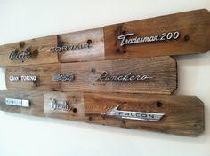 Handmade reclaimed wood art adorned with vintage auto emblems.. $229.00, via Etsy.