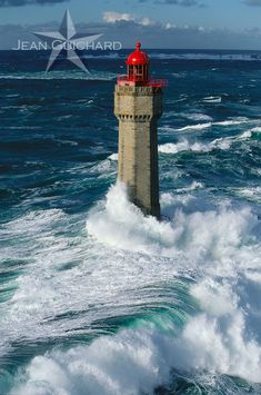 """Lighthouse of """"la Jument"""" in the storm. Erected on a stone called la Jument, """"Ar-Gazec"""" in breton. Sea of Iroise, west Brittany, France."""