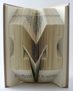 Artist Isaac Salazar uses origami and hand folding to recycle old books into art with his book sculptures. Book Crafts, Arts And Crafts, Paper Crafts, Book Works, Folded Book Art, Paper Book, Paper Folding, Old Books, Altered Books