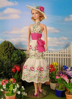 Fully lined, fitted halter dress. Dress is sewn entirely by hand from an exquisite, vintage hand-embroidered, petit point cotton hankie. Dress is lined in cotton and fastened with metal snaps. A rhinestone brooch accents the waist. Hat is hand crocheted and accented with a mulberry paper rose. Fashion includes dress and hat only.  This fashion is specially made to fit - Silkstone Barbie - Victoire Roux - Poppy Parker - and similar size dolls Fashion does not include doll, jewelry, gloves…