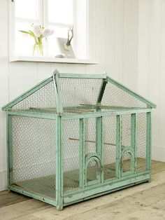 Home decor stores are full of little fake bird cages. This, I do not understand. Why have an empty, fake bird cage sitting in your home when. Fake Birds, Antique Bird Cages, Bunny Hutch, Indoor Rabbit, Bunny Cages, The Caged Bird Sings, Bird Aviary, Cottage In The Woods, Rabbit Hutches