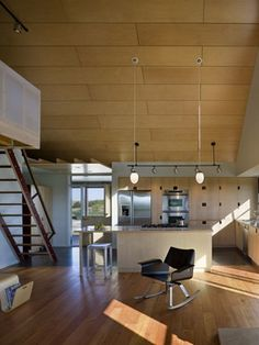 Perforated plywood used as ceiling panels solid plywood for Bleached maple kitchen cabinets