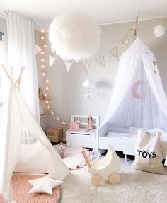 More magical styling by @interiorbysarahstrath featuring our Ooh Noo toy pram, Tellkiddo storage bag and Moon mobile. Dreamy products for a dreamy room  We have all of these available and ready to ship now at the link in our bio.