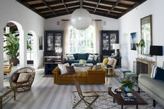 This living room, designed by Nate Berkus, looks long and spacious thanks to subtle gray stripes that extend across the space. The faint, simple shades allow for fun colors and patterns throughout the rest of the room to take center stage.  Source