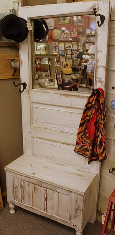 Old door with window above repurposed into furniture piece for halltree, bench, coat rack; Upcycle, Recycle, Salvage, diy, thrift, flea, repurpose, refashion! For vintage ideas and goods shop at Estate ReSale ReDesign, Bonita Springs, FL