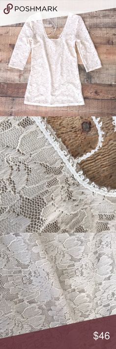 Free People Lacey Top Form fitting; lace affect; very pretty material with a crisscross of lace string on the back; perfect for someone who wear size Small or medium. Never worn; NWOT Free People Tops Blouses