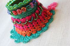Gladiolus imbricatus: freeform crochet bracelet with blue, emerald green…