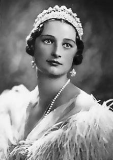 Queen Astrid, wife of King Leopold III, King of the Belgians.  Astrid was tragically killed in a car wreck on August 29, 1935.  She was 30 years old and left three small children.  The Belgian people still remember her as a beloved queen.  Her son is the reigning King Albert II.