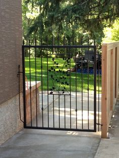 Sue Wahl - - wrought iron gate & wood fencing - Calgary