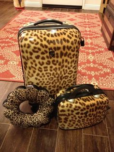Every gal should own a set of Heys leopard hard side luggage!  And, a leopard travel pillow.