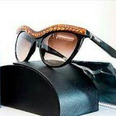 f2a39b9d806c Prada Sunglasses Prada Sunglasses New and Authentic Black frame with  crystals on front Includes original Prada case Prada Accessories Glasses