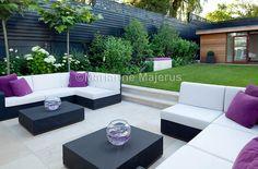 Spa Garden | Contemporary sofas and table on terrace in town garden | Charlotte Rowe Garden Design