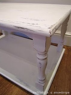My husband found this tired looking table at the side of the street... and gave it a new lease of life with a coat of white paint... we distressed the corners and crevices of the table with sandpaper to give a shabby chic country style look...