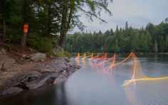whorls of color define stephen orlando's photo series, which sees him attach programmable LEDs to the paddle of a kayak.