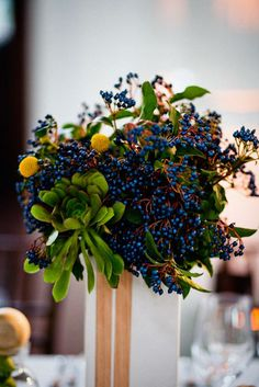 This floral centerpiece is absolutely striking, unique and gorgeous! #wedding #flowers