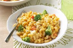 Frozen veggies cook with everyone's favorite mac and cheese for a fast—and smart—20-minute dish. For a fresh spin, use in-season veggies instead.