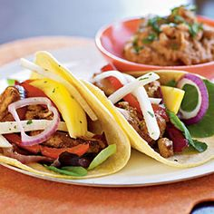 Fiesta Chicken Tacos with Mango and Jicama Salad. I think I'll try these some time soon. I don't think I've ever bought jicama.