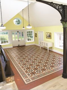 Victorian Floor Tiles - the Lindisfarne pattern with Stevenson border shows how you can add a sense of grandeur to a large space with an intricate, patterned tile floor.