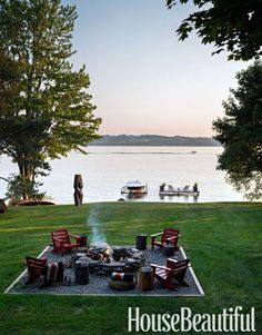 A fire pit, a dock, and a Gerald DiGiusto 1960s steel sculpture come together in designer Thom Filicia's yard at his rustic but sophisticated upstate New York lake house.