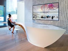 he SLO_Gen Table is a remarkable piece of innovation in the field of furniture design. The organic design is made using HI-MACS and has become the focal point of Gensler's Los Angeles office lobby! It was designed using the brief – create a piece that can accommodate standing and sitting space for guests and storage for the firm's design publications. Solid Surface HI-MACS is the table's predominant surface material and looks divine with the use of wood. It sports an awesome curvature.