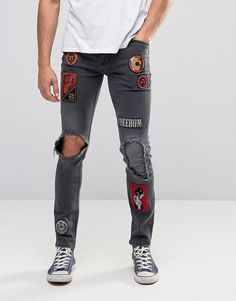 Image 1 ofASOS Skinny Jeans With Badges And Rip Detail