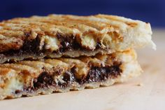 Peanut butter, Chocolate Chip, Banana Sandwich.  I used whole wheat bread instead of white and I made it like a regular grill cheese(in a pan) instead of using a press. Kids loved it!  Keeper :)