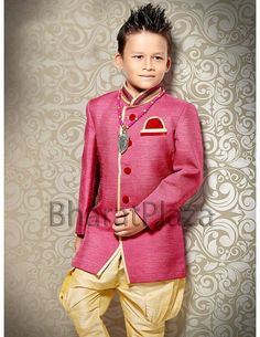 Stunning pink color indo western sherwani is invented on jute fabric having contrast piping on high neck collar, front panel, flap pocket and contrast velvet buttons will complete the party look of your little boy. Paired with dark cream color breeches. Kids Party Wear Dresses, Cute Dresses, Girls Dresses, Kids Wear Boys, Baby Girls, Baby Birthday, Birthday Bash, Indian Clothes, Indian Outfits