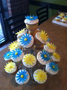 Airbrushed marshmallow fondant daisies on vanilla cupcakes.  Made for a little girl's Daisy ceremony (Daisy to a brownie scout).