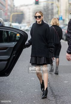 Olivia Palermo wearing black knit skirt outside Etro during Milan Fashion Week Fall/Winter 2017/18 on February 24 2017 in Milan Italy