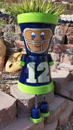 Clay Pots Seattle Seahawks man - Garden decoration yard art - terracotta pots craft - image only Flower Pot Art, Clay Flower Pots, Flower Pot Crafts, Clay Pot Projects, Clay Pot Crafts, Diy Clay, Shell Crafts, Flower Pot People, Clay Pot People