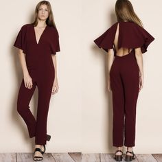 """Albatross"" Cape Backless Jumpsuit Low v-neck cape backless jumpsuit with a hidden back zipper. Available in black and burgundy. This listing is for the BURGUNDY. Brand new. Junior sizing. NO TRADES. PRICE FIRM. This is an actual pic of the item - all photography done by me. Please do not use pictures without permission. Bare Anthology Pants Jumpsuits & Rompers"