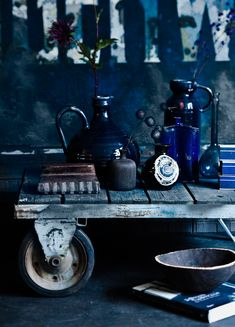 Love the deep blue vases. Inspiration for a vintage industrial blue decor. Find more industrial inspiration at www.FatShackVintage.com.au!