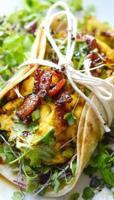 Farmers Market Breakfast Tacos by layersofhappiness: A simple, healthy recipe for some of the best breakfast tacos you'll ever eat – loaded with cheesy scrambled eggs, maple glazed bacon, fresh herbs, and a balsamic glaze. #Taco #Breakfast #Healthy